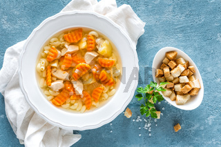Chicken soup, bouillon with meat, pasta and vegetables