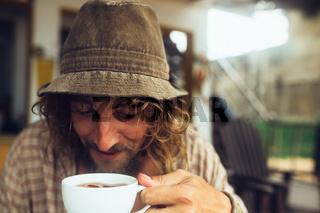 bearded guy drinking coffee