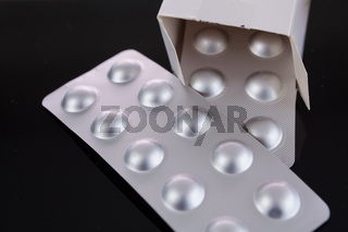 Silver blister pack of small pills