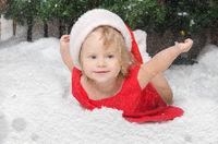 girl in santa costume on snow