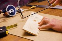 Carpenter at work cutting pine wood