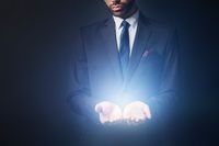 Light radiating from businessman hands