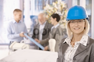 Portrait of female designer in hardhat
