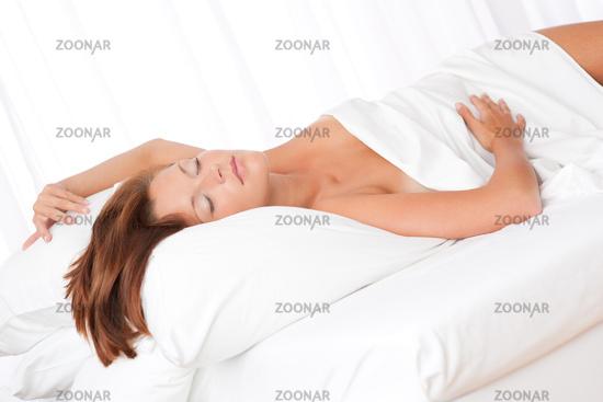 White lounge - Brown hair woman sleeping on white bed