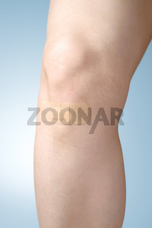 Plaster on female leg