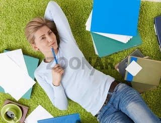 Smiling woman with documents