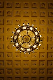 Chandelier on decoarted ceiling