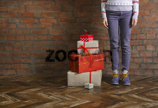 Christmas gifts and young woman