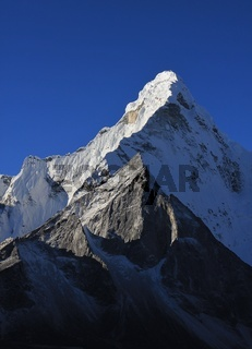 Pointed mt Ama Dablam and azure blue sky