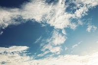 Clouds on blue sky.