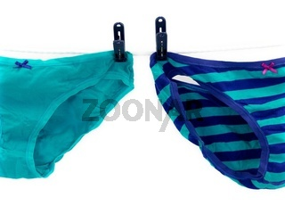 Underwear hanging from a clothes line isolated against a white background