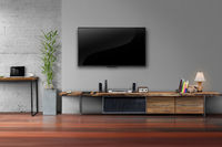 Led tv on gray wall color with wooden table media furniture