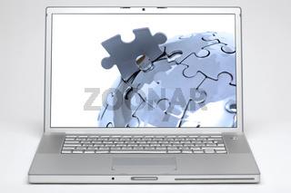 Laptop mit Globus im Monitor