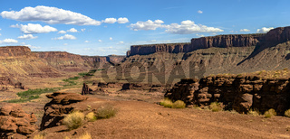 Canyon vies in Moab, Utah seen from the view of off-roading vehicles. Green area near the bottom of the canyon