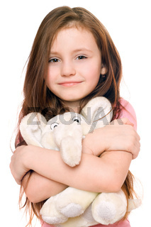 Portrait of smiling little girl with a teddy elephant. Isolated