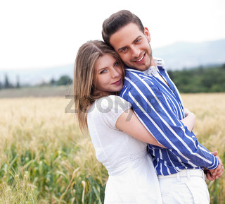 Happy young couple in the meadow