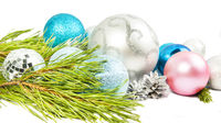 Christmas composition with fir tree branch, beautiful silver ball and silver cones isolated on white