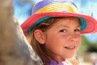 Girl wearing a straw hat
