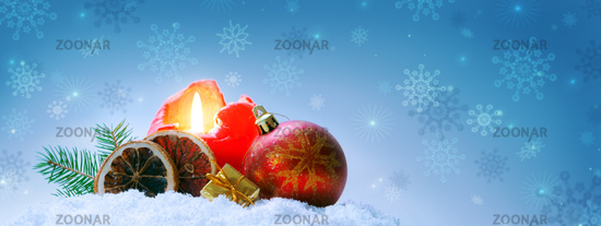Blue Christmas background with red advent candle .
