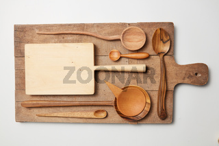 Various kitchen utensil on white wooden background