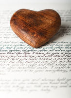 A wooden heart on a love letter