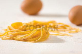 Closeup of uncooked tagliatelle pasta
