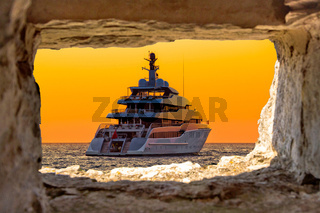 Luxury yacht through stone window view