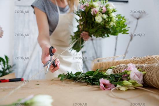 Girl florist makes beautiful bouquet