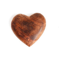 A wooden heart isolated on white background
