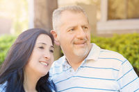 Portrait of smiling middle-aged couple looking forward