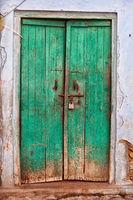 Ancient green wooden door, India