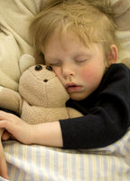 Sleeping child with teddy