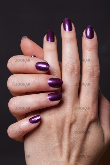 Close up of female hands over black