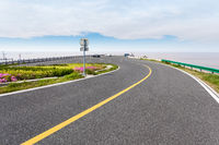 asphalt road by the sea