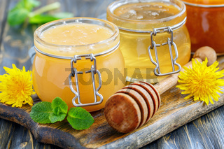 Floral and linden honey in glass jars.