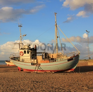 Beautiful fishing boat on the beach. Summer scene at the Slettestrand, Denmark.
