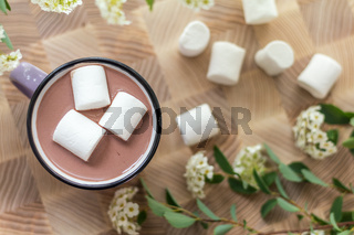 Marshmallows on top of hot cocoa in pink cup