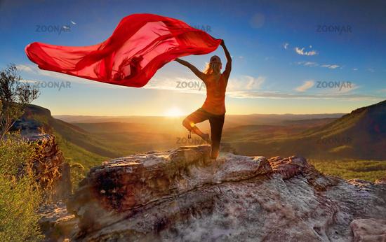 Woman Pilates Yoga balance  with sheer flowing fabric