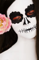 woman with black and white face art on her face