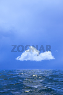 Background of sky with a single cloud reflected in water or ocea