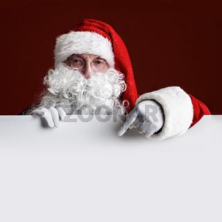 Santa Claus with big blank card