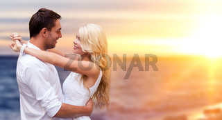 happy couple hugging over sea background