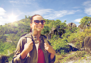 happy young woman with backpack traveling
