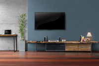 Living room led tv on dark blue wall with wooden table media furniture