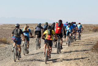 Mountain biker racing on desert road