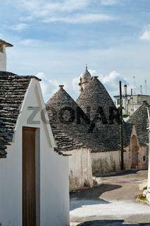Typical street with Trulli houses in Alberobello, Puglia, Italy