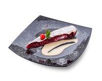 Piece of cherry pie on black dish