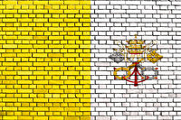 flag of Vatican State painted on brick wall