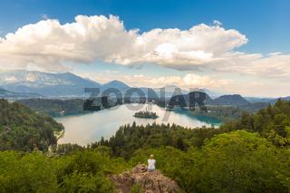 Woman enjoying panoramic view of Lake Bled, Slovenia.