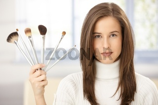 Woman with makeup brush collection